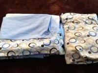 I have a 4 piece boys blue and brown crib bedding set.