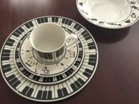 Whimsically musical 4 place setting dishes. Includes,