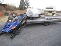 This is a Leland 8X18 Snowmobile / Quad trailer. Has