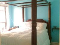 4 post queen bed and 2 end tables. All currently fit in