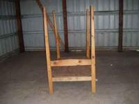 "Made of pine - 40"" wide, 62"" long, 6' high. Used in a"