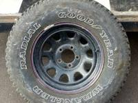 There are 4 Radial Goodyear Wrangler tires and then an
