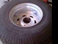 4- WELD RIMS AND 12.5X35 BF GOODRICH TIRES, TIRES HAVE