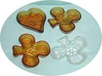 I have for sale 4 Indiana glass candy dishes, 3 clover