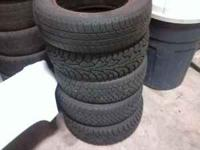 4 snow tires on steel wheels for sale. 2 are near new