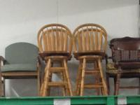 4 SOLID OAK 24 INCH BAR STOOLS!  $100.00.  KINDLY CALL