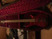electric 4-string bass by rogue with new strings with