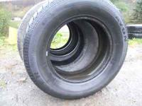 Four used tires in good condition. Two are Ranger Avon