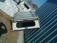 Four truck toppers for sale. All fit Chev. Chevy S-10,