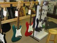 In stock right now! Four used Fender Strats: Red, Blue