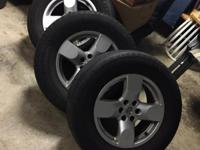 (4) aluminum rims and tires for a 2008 Nissan Xterra.