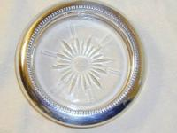 I have for sale 4 vintage silver plate crystal coasters