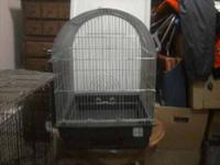 -White with blue small cage. Good condition. $12 -Black