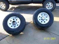 These wheels fit chevys and have 6 lugs. $120.00