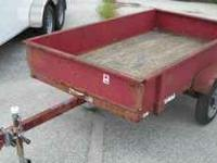 4 X 8 Utility trailer solid sides good condition tires