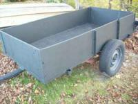 "Heavy duty 4' X 8' utility trailer with 15"" tires."