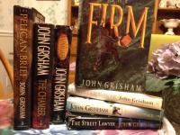 8 book collection of Jon Grisham including The Pelican
