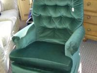 Good condition used green upholstered rocking chair
