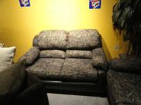 On liquidation sale is this pristine camo sofa