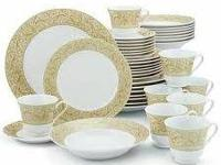 This is a 40 piece dinnerware set by Chris madden