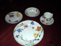"This dinnerware set is the ""Summer Meadow"" pattern made"