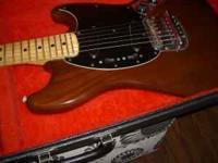 Made in the USA, 1970's fender mustang guitar. Comes