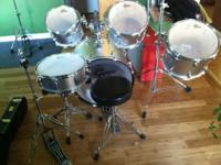 This is a barely used silver Gretsch drum set. It has