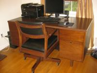 A very nice looking yet practical desk manufactured by