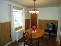 Oak dining room set and matching china hutch. Table has