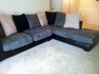 "Couch is ""L"" shaped with longest side extending to the"