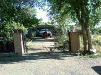 This beautiful lot is paved, gated, shaded with large