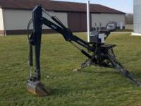 Up for sale is a Long agribusiness backhoe attachment.