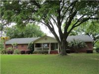 A wonderfully kept home on 8+/- acres simply outside