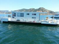 THIS 40 FT HOUSEBOAT HAS A LARGE REAR DECK AND SWIM