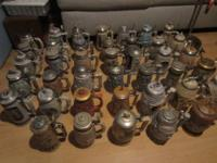 This listing is for 41 Avon Ceramarte Beer Steins.