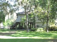 Beautiful 98' of Caney Creek frontage with huge Oaks,