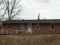 3 Bedroom Brick home with garage sitting at the end of