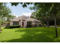 A 1-story home with a pool, a level .44 acre,