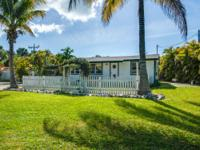 "Cute ""fixer-upper"" Sanibel Cottage located on over half"