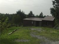 Country retreat, this 13.37 Acre tract with home offers