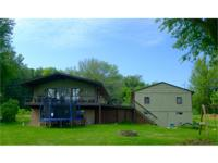 Get ready for lake living fun! Priced to sell, this