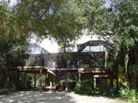 One of a kind country estate! Nestled in the oaks on