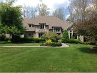 An immaculate French Country home, 4BR, 3.5 BA, on