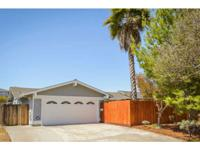 Located on a large, flat lot, this roomy houses boasts