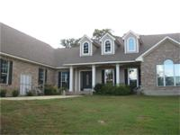 Lovely 3/2 custom home on 3 lots, one a corner lot. The