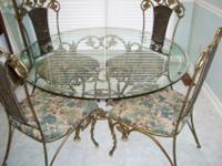 Unique 42 inch heavy glass top table with 4 chairs and