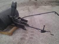 This is an almost new snow blower attachment for an MTD