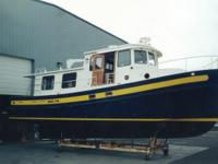 Description This 1995 Nordic Tug 42 has a dark blue