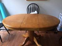 "Light colored wood pedestal table. 42"" Round with 15"""