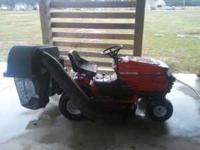 Yard machine 42 inch mower with bagger attachment. Has